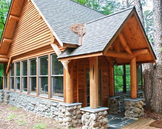 log truss entryway on cabin