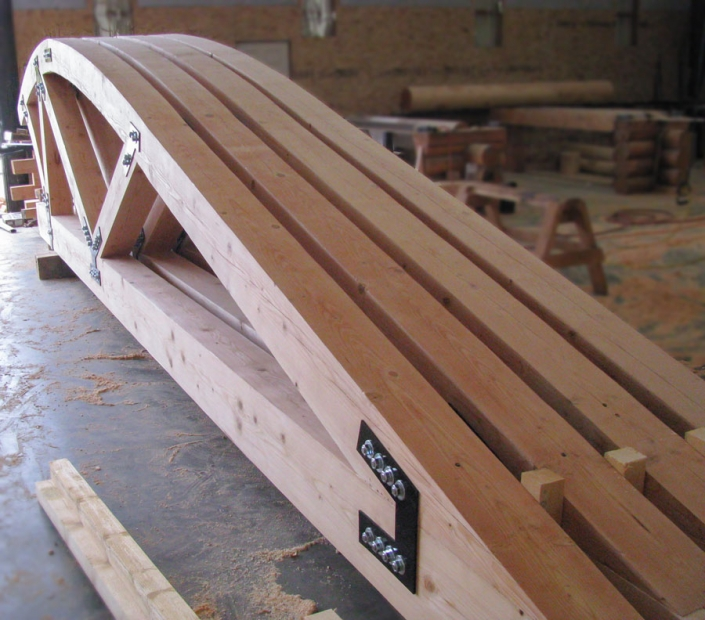 Arched curved timber trusses ready to ship