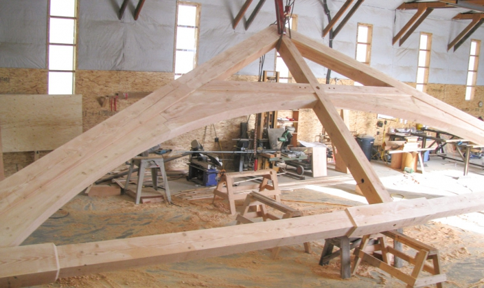 arched truss timber frame building