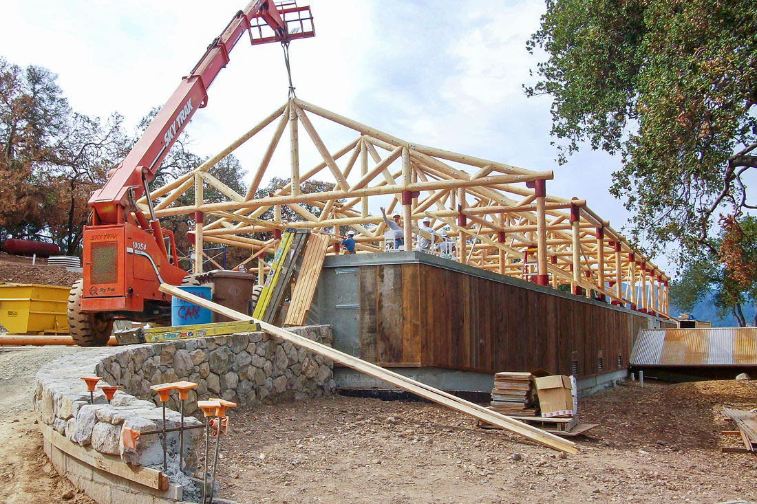 setting log trusses at a winery