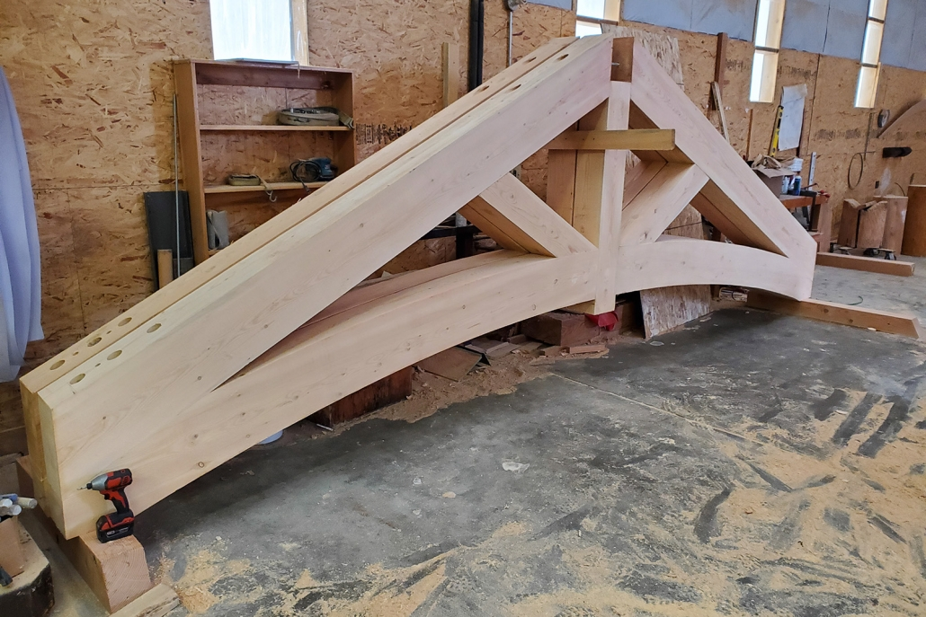 using internal bracing on timber frame truss lowers costs