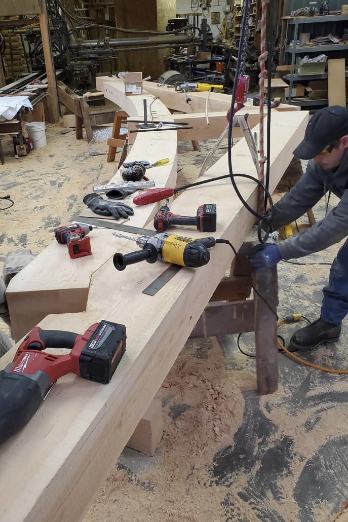 woodworker finishing trusses at Montana Timber